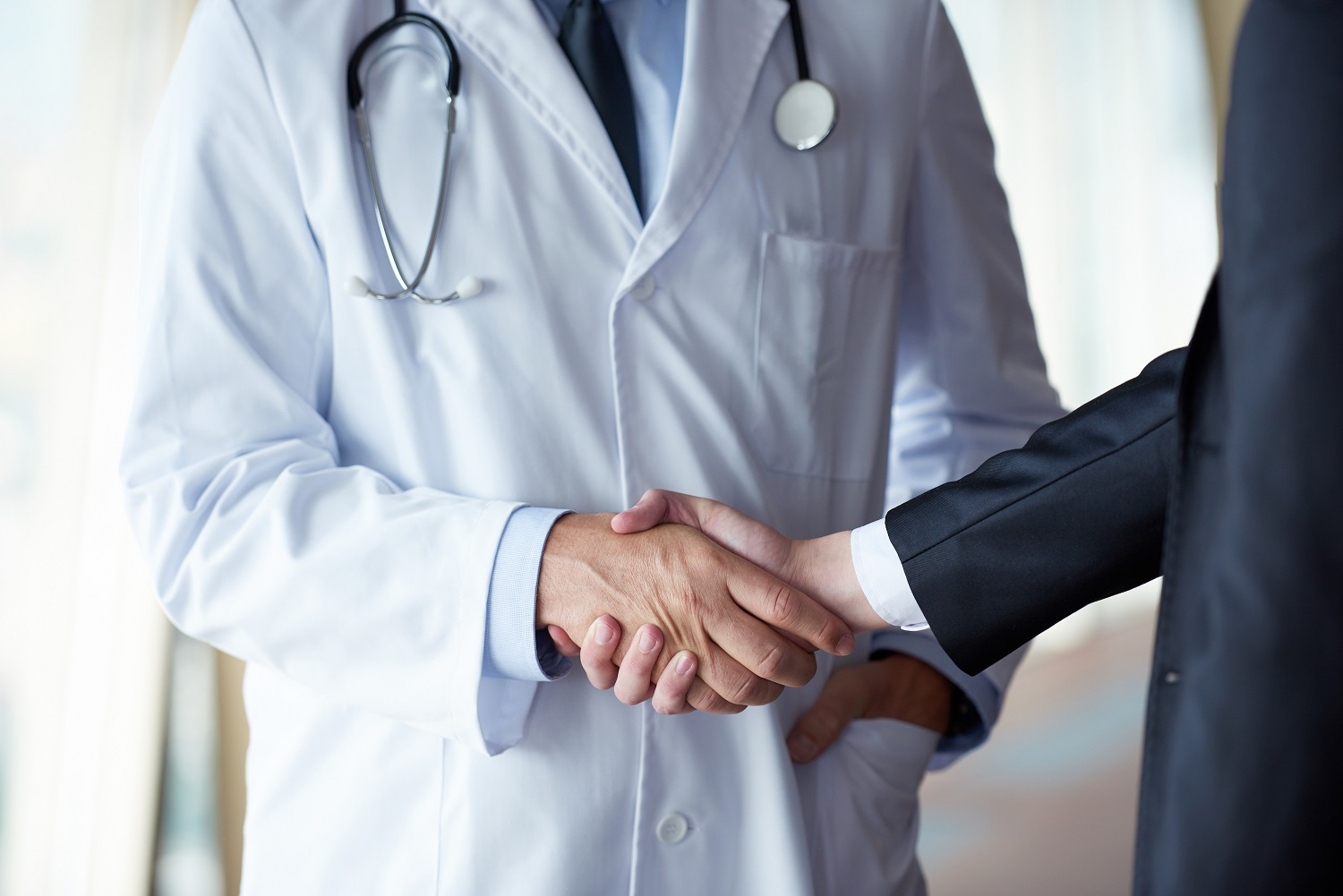 doctor handshake with a patient